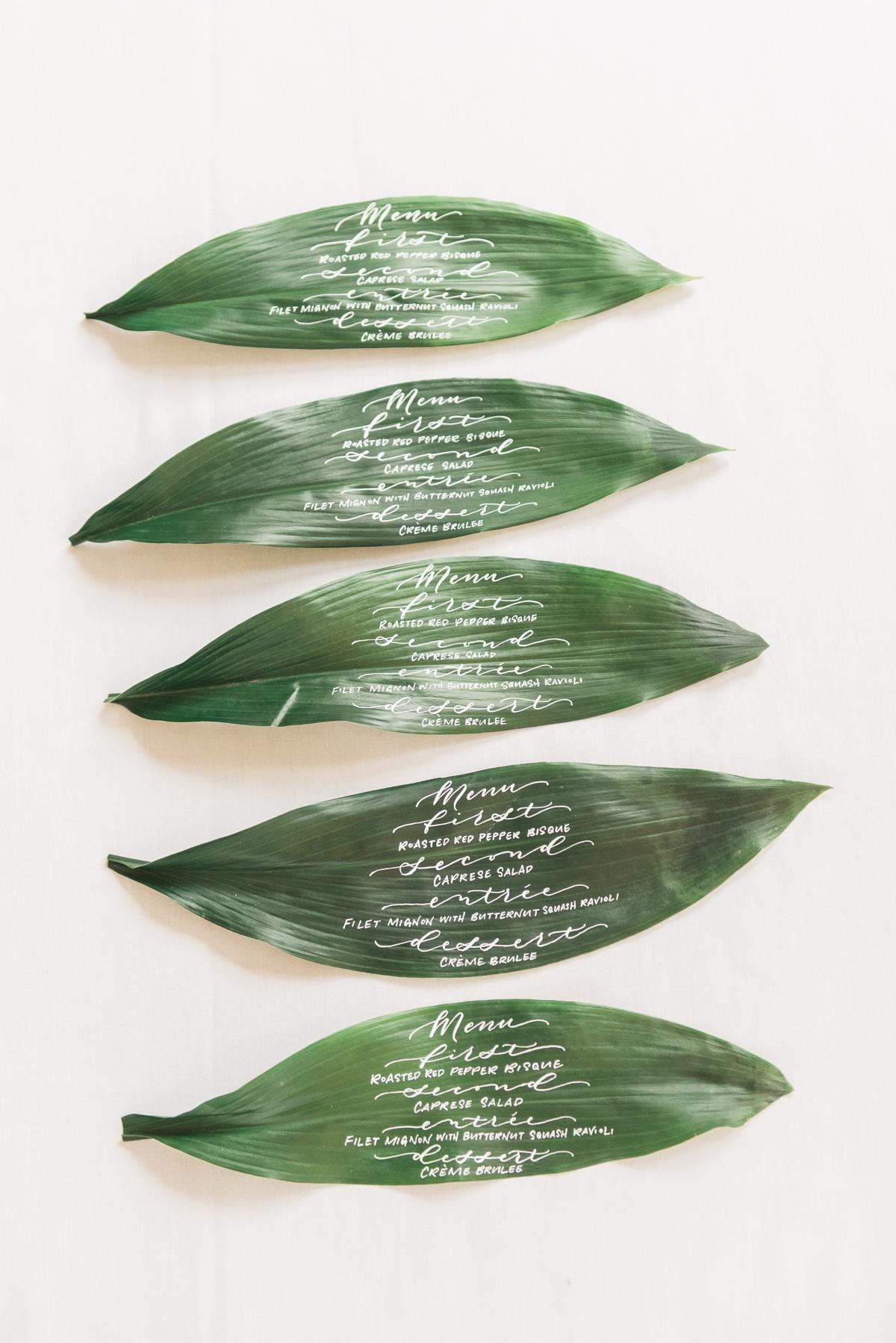 calligraphy menu on banana leaf