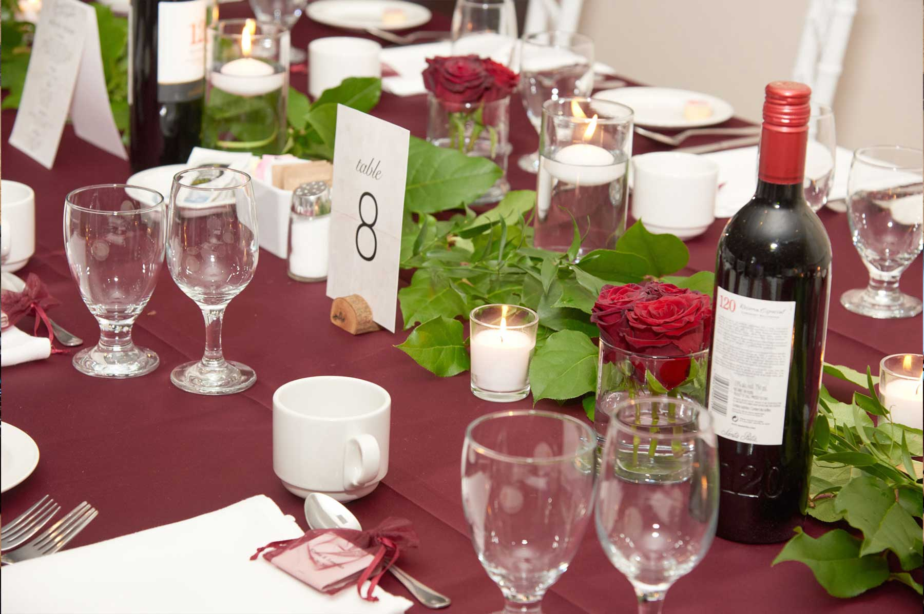Greenery filled event with pops of Marsala