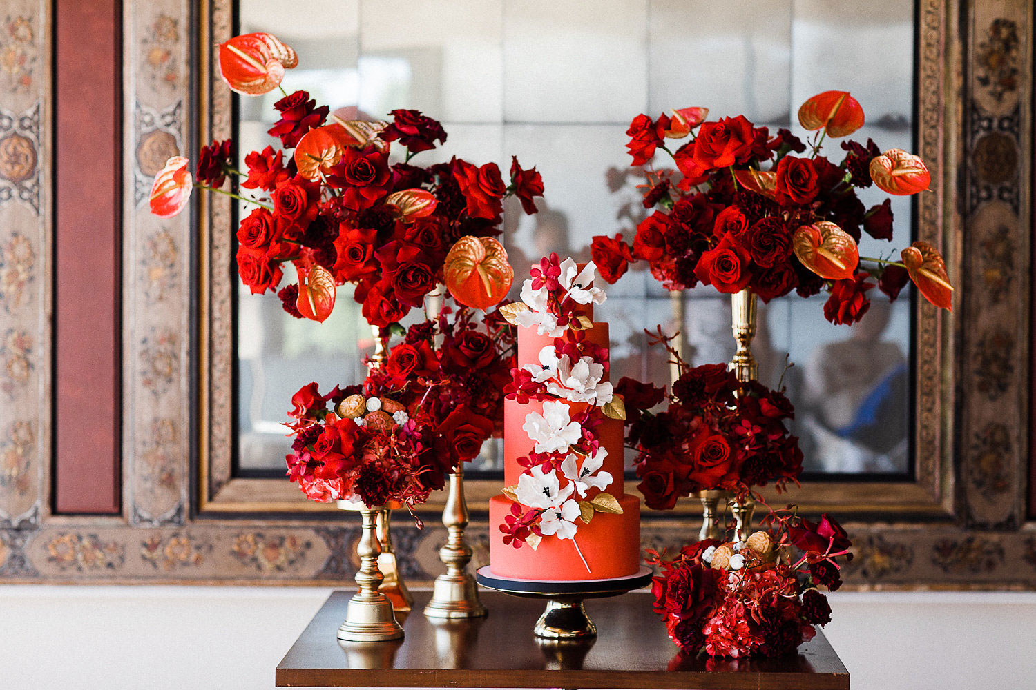 luxury wedding cake table filled with flowers