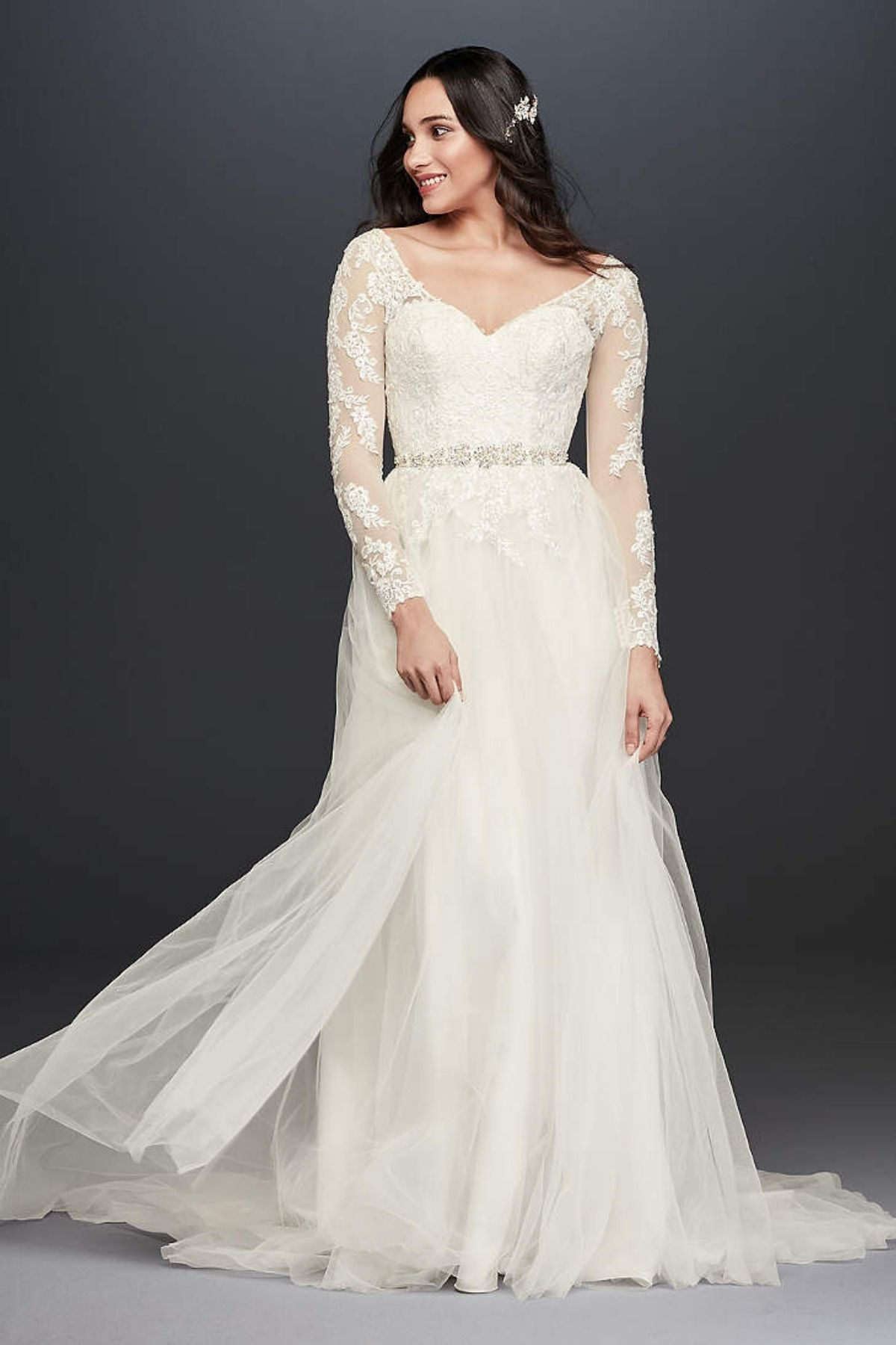 3. Long Sleeve Wedding Dress With Low Back