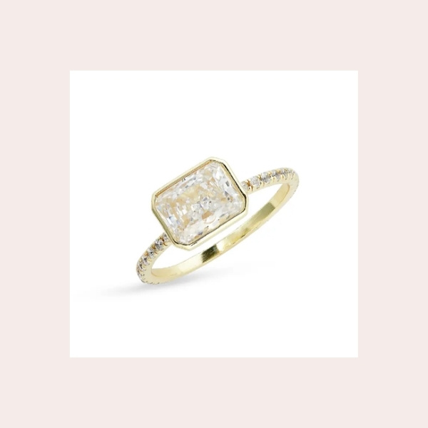 MELINDA MARIA The Lisa Cubic Zirconia Ring $58.00 | A dazzling emerald-cut stone framed by sparkling pavé cubic zirconia takes center stage on this statement ring plated in 18-karat gold.